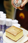 An exhibitor sprays edible gold on a cake during the 42nd International Food and Beverage Exhibition (FOODEX JAPAN 2017) in Makuhari Messe International Convention Complex on March 8, 2017, Chiba, Japan. About 3,282 companies from 77 nations are participating in the Asia's largest food and beverage trade show. This year organizers expect 77,000 visitors for the four-day event, which runs until March 10. (Photo by Rodrigo Reyes Marin/AFLO)