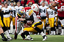 25 November 2011: Quarterback James Vandenberg #16 of the Iowa Hawkeyes is tackled by linebacker Lavonte David #4 of the Nebraska Cornhuskers at the Memorial Stadium in Lincoln, Nebraska. Nebraska defeated Iowa 20 to 7.