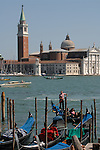 Gondola on the lagoon against the background of San Giorgio Maggiore. Venice, Italy.