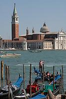 Gondola on the lagoon against the background of San Giorgio Maggiore. Venice, Italy.