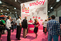 Smöoy, a Spanish frozen yogurt company, gives away free samples in the Jacob Javits Convention Center in New York on Thursday, June 19, 2014 at the International Franchise Expo. Over 400 exhibitors meet approximately 19,000 attendees seeking to start their own businesses. The exhibitors run the gamut from small businesses hoping to expand to well established juggernauts who want to add franchisees in underrepresented territories. (© Richard B. Levine)