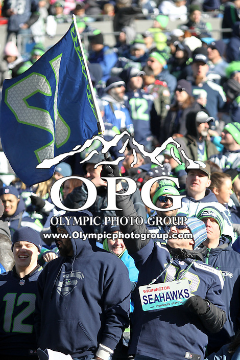 2014-02-05:  Seattle Seahawk Heath Farrell let fans get an up close look at the Lombardi Trophy. Seattle Seahawks players and 12th man fans celebrated bringing the Lombardi trophy home to Seattle during the Super Bowl Parade at Century Link Field in Seattle, WA.