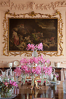 William Mathie`s jacobo Bassano canvas in the pink dining room is somewhat out staged by a colourful flower arrangement on the dining table