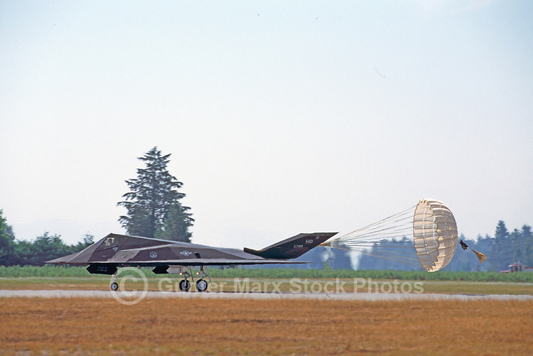 US Air Force Lockheed F-117A Nighthawk Stealth Fighter deploying Brake Parachute to assist in landing on Runway - at Abbotsford International Airshow, BC, British Columbia, Canada
