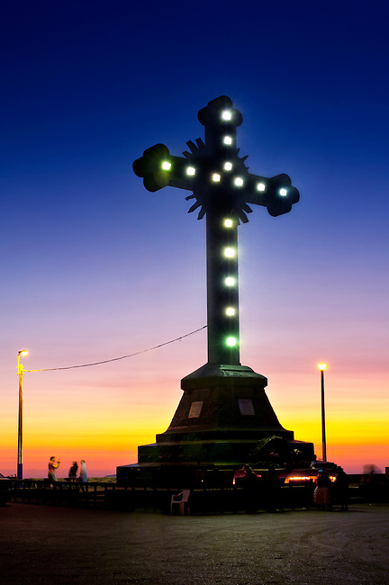 The illuminated cross on top of Cerro de San Cristobal.  The hill provides visitors with great views of Lima.  The cross was erected in 1928 and traces back to when  Fancisco Pizarro celebrated his victory over the Incans in 1535.