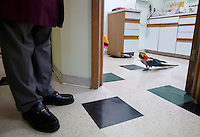 Dr. Ram Mohan stands outside of the Avian Health Clinic's exam room, where a Macaw parrot awaits treatment on Nov. 3, 2012. The clinic treats many varieties of parrots, as well as the occasional duck and chicken. The clinic is open on weekdays and Saturdays, and Dr. Mohran remains on call over weekends for avian veterinary emergencies.