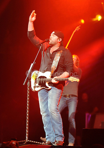 "New York, NY-September14:  Lee Brice performs on stage as part of the 2014 ""That's My Kind Of Night Tour"" on September 14, 2014 at the Barclays Center in Brooklyn, New York. Credit: John Palmer/MediaPunch"