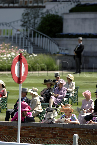 15 June 2004: Racegoers in the Royal Enclosure at Royal Ascot Photo: Steve Bardens/Action Plus...horse racing 040615 fashion hat hats wall post finish