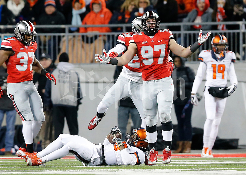 Ohio State Buckeyes defensive lineman Joey Bosa (97) celebrates a sack of Illinois Fighting Illini quarterback Aaron Bailey (15) during the second quarter of the NCAA football game at Ohio Stadium on Nov. 1, 2014. (Adam Cairns / The Columbus Dispatch)