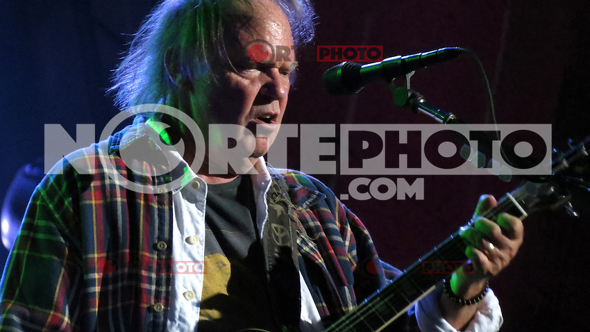 NEW YORK, NY - SEPTEMBER 29; Neil Young performing at the Global Citizen Festival at Central Park in New York Ciity on September 29, 2012. © Jen Maler/MediaPUnch Inc.