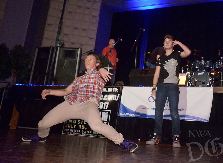 NWA Democrat-Gazette/BEN GOFF @NWABENGOFF<br /> Zane Lovelady (left) and Spencer 'Gravity' Meier, both Bentonville High seniors, entertain the audience with their animation dance routine between musical acts Saturday, July 15, 2017, during the Bentonville Alumni Association's 4th annual Sweet Jam Music Fest at Meteor Guitar Gallery in downtown Bentonville. The festival is a fundraiser that helps support scholarships the association gives each year to seniors in the Bentonville school district.