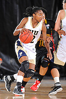 25 November 2011:  FIU guard Jerica Coley (22) handles the ball in the first half as the University of Maryland Terrapins defeated the FIU Golden Panthers, 84-52, at the U.S. Century Bank Arena in Miami, Florida.