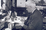 A picture of Alexander Fleming in his laboratory.