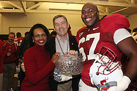 STANFORD, CA - NOVEMBER 28:  Condoleezza Rice, Bob Bowlsby, and Allen Smith of the Stanford Cardinal after Stanford's 45-38 win over the Notre Dame Fighting Irish on November 28, 2009 at Stanford Stadium in Stanford, California.