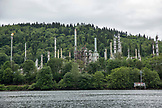 CANADA, Vancouver, British Columbia, a large factory sits along the waters edge in the Burrard Inlet