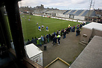 Spectators in front of the main stand watching the action at Bellslea Park, during Fraserburgh's Highland League fixture against visitors Strathspey Thistle (in blue). Nicknamed 'The Broch,' Fraserburgh have been members of the Highland League since 1921 having been formed 11 years earlier. The match ended in a 2-2 draw in front of a crowd of 302.