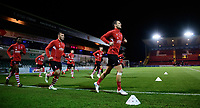 Lincoln City's Jason Shackell, right, during the pre-match warm-up<br /> <br /> Photographer Chris Vaughan/CameraSport<br /> <br /> The EFL Checkatrade Trophy Northern Group H - Lincoln City v Wolverhampton Wanderers U21 - Tuesday 6th November 2018 - Sincil Bank - Lincoln<br />  <br /> World Copyright © 2018 CameraSport. All rights reserved. 43 Linden Ave. Countesthorpe. Leicester. England. LE8 5PG - Tel: +44 (0) 116 277 4147 - admin@camerasport.com - www.camerasport.com