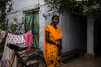 Sushila Purty, 30 years old, lives in Shankosai, Jamshedpur. Sushila is standing in the courtyard that separates her room from her accusers room (green door behind her). In May 2012, her neighbours accused her of being a witch after their kid died of fever. Sushila was attacked twice by an angry mob, but survived thanks to the help of her landlord. Her attackers fled, but she was threatened with death if any other people will fall sick in the neighbourhood.