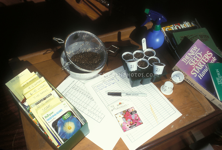 Seed starting equipment for garden plants, using individual pots, books, seed packets, record keeping, growing medium and sieve, watering sprayer
