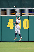 Mississippi Braves outfielder Cedric Hunter (17) jumps to catch a fly ball over his head during a game against the Montgomery Biscuits on April 22, 2014 at Riverwalk Stadium in Montgomery, Alabama.  Mississippi defeated Montgomery 6-2.  (Mike Janes/Four Seam Images)