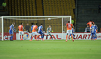 BOGOTA - COLOMBIA – 21-08-2014: Andy Pando (Der.) jugador de Universidad Cesar Vallejo C. F. de Peru, anota gol a Luis Delgado (Cent.) portero de  Millonarios de Colombia durante partido de ida de la primera fase, llave G14 de la Copa Total Suramericana entre Millonarios de Colombia y Universidad Cesar Vallejo Club de Futbol de Peru, en el estadio Nemesio Camacho El Campin de la ciudad de Bogota. / Andy Pando (R) player Universidad Cesar Vallejo Club de Futbol of Peru, scored a goal to Luis Delgado (C) goalkeeper of Millonarios of Colombia, during a match for the first leg, of the first phase, Key G14 between Millonarios de Colombia and Universidad Cesar Vallejo Club de Futbol of Peru of the Copa Total Suramericana in the Nemesio Camacho El campin Stadium in Bogota city. Photos: VizzorImage / Luis Ramirez / Staff.