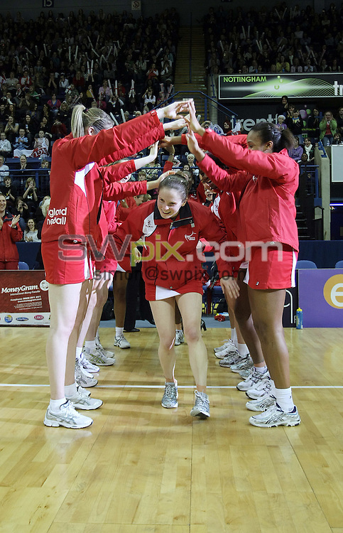 PICTURE BY VAUGHN RIDLEY/SWPIX.COM - Netball - The Co-Operative International Series - England v Jamaica, Third Test - Trent FM Arena, Nottingham, England - 26/02/09...Copyright - Simon Wilkinson - 07811267706...England's Karen Atkinson receives an award after playing her 100th match for England.
