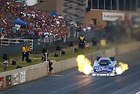 Jul. 18, 2014; Morrison, CO, USA; NHRA funny car driver Tommy Johnson Jr during qualifying for the Mile High Nationals at Bandimere Speedway. Mandatory Credit: Mark J. Rebilas-
