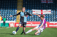 Jason McCarthy of Wycombe Wanderers on the ball as Harry Taylor of Barnet slides in during the Sky Bet League 2 match between Wycombe Wanderers and Barnet at Adams Park, High Wycombe, England on 16 April 2016. Photo by Andy Rowland.