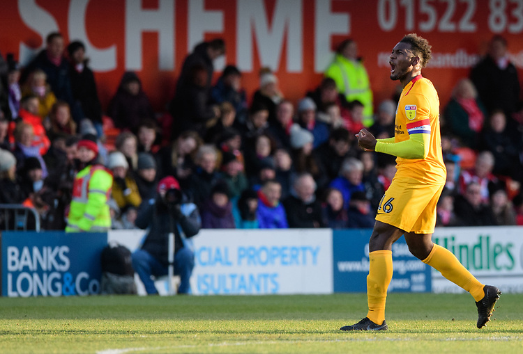 Northampton Town's Aaron Pierre celebrates scoring his side's equalising goal to make the score 1-1<br /> <br /> Photographer Chris Vaughan/CameraSport<br /> <br /> The EFL Sky Bet League Two - Lincoln City v Northampton Town - Saturday 9th February 2019 - Sincil Bank - Lincoln<br /> <br /> World Copyright &copy; 2019 CameraSport. All rights reserved. 43 Linden Ave. Countesthorpe. Leicester. England. LE8 5PG - Tel: +44 (0) 116 277 4147 - admin@camerasport.com - www.camerasport.com