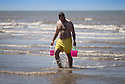 17/06/14 <br /> <br /> A man carries two buckets on the beach at Blackpool.<br /> <br /> All Rights Reserved - F Stop Press.  www.fstoppress.com. Tel: +44 (0)1335 300098