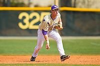 Western Carolina Catamounts first baseman Austin Neary (33) flips the ball to the pitcher during the game against the Davidson Wildcats at Wilson Field on March 10, 2013 in Davidson, North Carolina.  The Catamounts defeated the Wildcats 5-2.  (Brian Westerholt/Four Seam Images)
