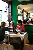 BRAZIL, Rio de Janiero, three individuals enjoy lunch at Casa de Feijoada