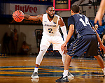 BROOKINGS, SD - NOVEMBER 1: Tevin King #2 from South Dakota State University controls his dribble against Allec Williams #14 from South Dakota School of Mines during their exhibition game Thursday night at Frost Arena in Brookings. (Photo by Dave Eggen/Inertia)