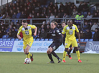 John McGinn gets away from Jackson Irvine in the Ross County v St Mirren Scottish Professional Football League match played at the Global Energy Stadium, Dingwall on 17.1.15.