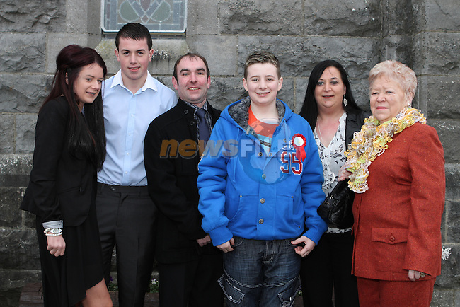 Aaron Butler with his family at his Confirmation in Tullyallen Church...(Photo credit should read Jenny Matthews/NEWSFILE)...