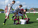 Queen Park's Shaun Rooney (14) clashes with Joshua Watt (15).