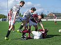 Queen Park's Shaun Rooney (14) clashes with Joshua Watt (15).