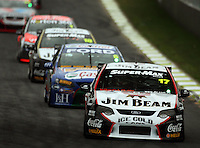 Steven Johnson leads down the home straight in Race Two during Day Three of the Hamilton 400 Aussie V8 Supercars Round Two at Frankton, Hamilton, New Zealand on Sunday, 19 April 2009. Photo: Dave Lintott / lintottphoto.co.nz