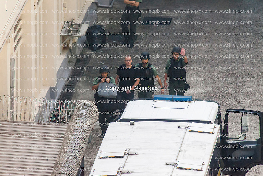 British ex-banker Rurik Jutting walks through a courtyard at the Lai Chi Kok Reception Centre shortly before boarding a high security prison van which will bring him to his trial at the High Court of Hong Kong for the alleged killing of two Indonesian women in October 2014, Hong Kong, China, 01 November 2016.