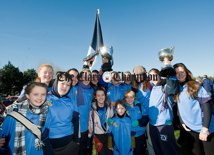 The Truagh Camogie players show off their trophies at the official opening of Fr Mc Namara Memorial Park in Doora. Photograph by John Kelly.