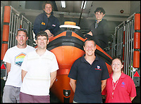 BNPS.co.uk (01202 558833)<br /> Pic :  RichardHorobin/BNPS<br /> <br /> The day after the dramatic rescue....<br /> <br /> Archie Woollacott (top right), with members of Lyme Regis lifeboat - and the lemon drizzle cake on top of the boat.  Lifeboat crew are (top left) Murray Saunders, then front left to right  -   Elliott Herbert, Tim Edwards, Andy Butterfield and Nikki Williams.<br /> <br /> This is the dramatic moment two teenage tombstoners were saved from drowning after they were swept 250 yards out to sea.<br /> <br /> Archie Woollacott, 14, got dragged away by a strong current after plunging off a harbour wall at Axmouth, Devon. His friend Bozhidrar Bobev jumped in to rescue him but was also taken out to sea.<br /> <br /> The stricken pair spent an hour treading water before they were spotted by the Lyme Regis lifeboat crew in the nick of time.<br /> <br /> The next day Archie visited to RNLI station to thank the crew by baking them a lemon drizzle cake.