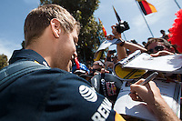 March 13, 2014: Sebastian Vettel (DEU) from the Infiniti Red Bull Racing team signs autographs at the 2014 Australian Formula One Grand Prix at Albert Park, Melbourne, Australia. Photo Sydney Low.