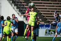 Seattle, WA - Sunday, April 17, 2016: Seattle Reign FC defender Kendall Fletcher (13) goes up against Sky Blue FC goalkeeper Caroline Casey (27) at Memorial Stadium. Sky Blue FC defeated the Seattle Reign FC 2-1during a National Women's Soccer League (NWSL) match at Memorial Stadium.