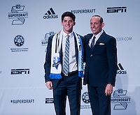 #5 overall pick Eric Miller of the Montreal Impact stands with MLS commissioner Don Garber during the MLS SuperDraft at the Pennsylvania Convention Center in Philadelphia, PA, on January 16, 2014.