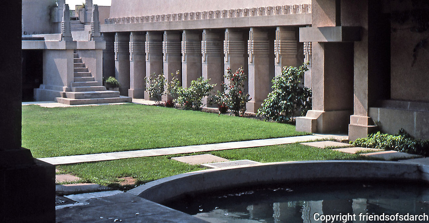 Frank Lloyd Wright:  Aline Barnsdall 'Hollyhock House', Hollywood, 1917.  Masses of concrete and hollyhock motif. Courtyard with pond. Photo May 1982.