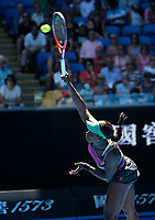 14th January 2019, Melbourne Park, Melbourne, Australia; Australian Open Tennis, day 1; <br /> Sloane Stephens of USAserve  the ball in the match against Taylor Townsend of USA