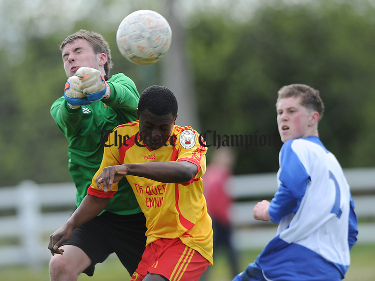 Sean Kennedy and Shane Daly of Ennis Town Rock in action against Segan Junaid of Avenue United during their Youths Cup final at Doora. Photograph by John Kelly.