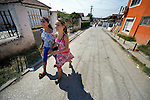 "THIS PHOTO IS AVAILABLE AS A PRINT OR FOR PERSONAL USE. CLICK ON ""ADD TO CART"" TO SEE PRICING OPTIONS.   Esmeralda and Semirah Redjepi are Roma youth in Suto Orizari, the Macedonian municipality that is Europe's largest Roma settlement. Here the sisters walk to school."