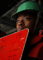 080522-N-7981E-062 ARABIAN GULF (May 22, 2008)- Seaman Shequena Bannister  signals to riggers on fast combat support ship USNS Rainer (T-AOE 7) as Nimitz-class aircraft carrier USS Abraham Lincoln (CVN 72) receives stores during an underway replenishment. Lincoln is deployed to the U.S. Navy 5th Fleet area of responsibility to support Maritime Security Operations (MSO). MSO help develop security in the maritime environment, which promotes stability and global prosperity.  These operations complement the counterterrorism and security efforts of regional nations and seek to disrupt violent extremists' use of the maritime environment as a venue for attack or to transport personnel, weapons or other material. U.S. Navy photo by Mass Communication Specialist 2nd Class James R. Evans (RELEASED)