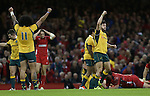 The Australian players Joe Tomane and Adam Ashley-Cooper celebrate at the final whistle after victory over Wales.<br /> Dove Men Series 2014<br /> Wales v Australia<br /> Millennium Stadium<br /> 08.11.14<br /> &copy;Steve Pope-SPORTINGWALES